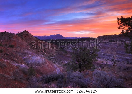 HDR landscape - vibrant desert sunrise from Gooseberry Mesa with the temples of Zion National Park, Utah, USA in the distance. - stock photo