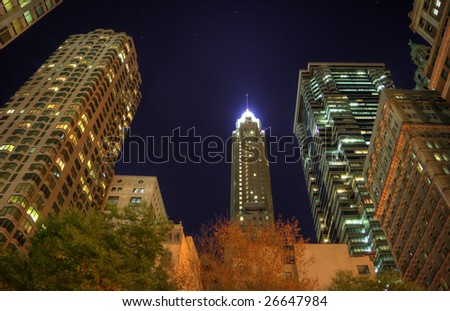 HDR night image of a group of buildings in the NYC financial district. Some chromatic aberration is inevitable with this kind of image. - stock photo