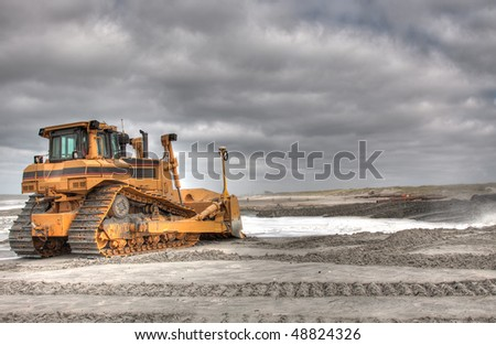 HDR of a Bulldozer ready for action - stock photo
