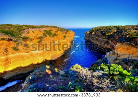 HDR of cliffs and bay - stock photo