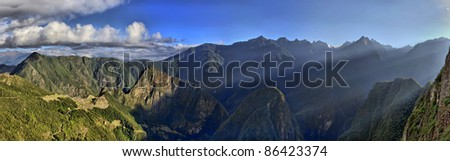 HDR Panorama of Sunrise over the Ruins Machu Picchu - Sacred city of the Incas