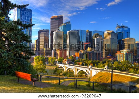 HDR Park bench overlooking Skyscrapers of Calgary, Alberta, Canada - stock photo