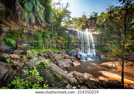 HDR photo image of tropical waterfall  - stock photo