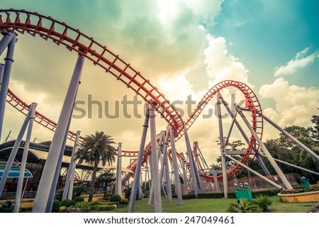 HDR photo of a Colorful Looping Roller Coaster On A Beautiful Sunny Day in Thailand - stock photo