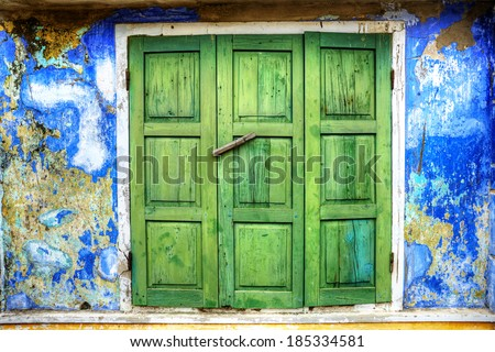 HDR photo of an old door in Hoi An, Vietnam - stock photo