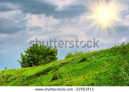 HDR photo with the image of the sun against the backdrop of cloudy skies in the summer period