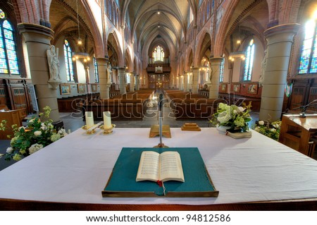 HDR picture of an interior of a catholic church in The Netherlands - stock photo