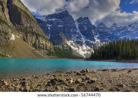 HDR Rocky mountain peaks and moraine lake - stock photo