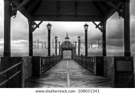 HDR shot of a pier in black and white - stock photo