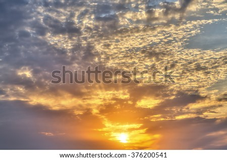 HDR shot of sunset with cloudscape for backgrounds - stock photo