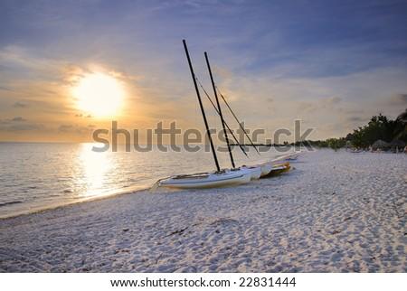 Hdr shot of tropical cuban beach at sunset - Ancon beach, cuba - stock photo