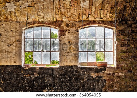 HDr shot of two broken window in an old house - stock photo
