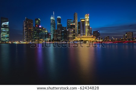 HDR Skyline View of Singapore City from the Water at Night! - stock photo