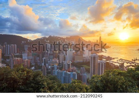 HDR: Sunset in hong kong city Skyline from braemar hill - stock photo