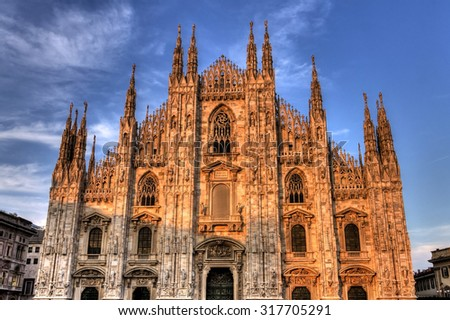HDR sunset photo of the famous Cathedral Duomo di Milano on piazza in Milan, Italy  - stock photo