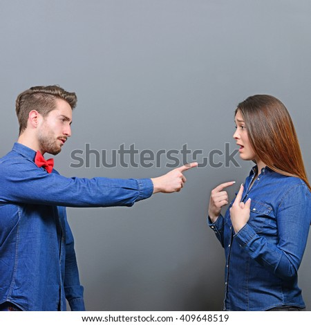 He accusing her - Couple fighting series - stock photo