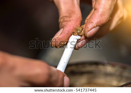 He hand-rolled marijuana closeup.