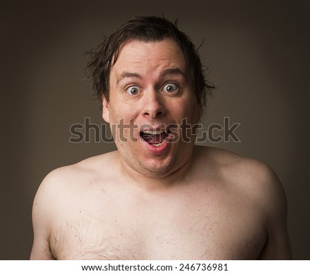 He has a crazy smile or something on his face - stock photo