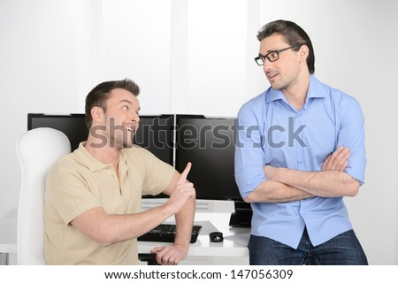 He has another point of view. Two young businessmen talking about business and gesturing - stock photo