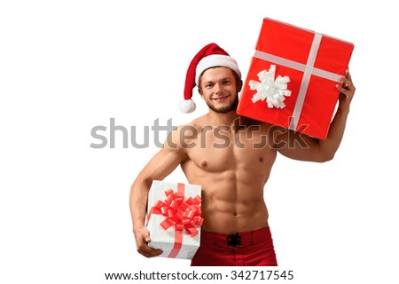 He has got something special. Horizontal shot of a sexy Santa Claus with toned body holding two presents isolated on white