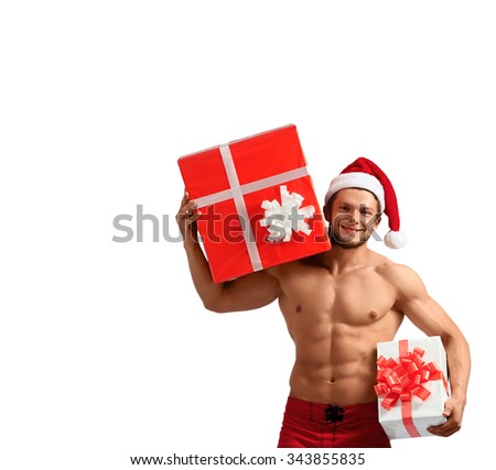 He has something to offer. Cropped shot of an attractive naked Santa Claus isolated on white with a copyspace on the side - stock photo