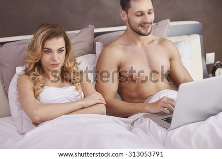 He is a workaholic and she is simply angry - stock photo