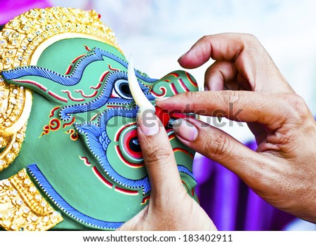 He is fixing Khon Masks for khon drama  - stock photo