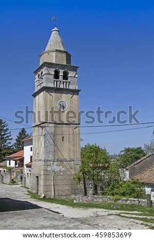 he isolated bell tower of the parish church in the idyllic village Krsan - stock photo