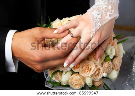 He Put the Wedding Ring on Her - stock photo