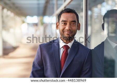 He's a businessman in the modern corporate world - stock photo