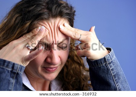 Head ache pains on a blue background II - stock photo