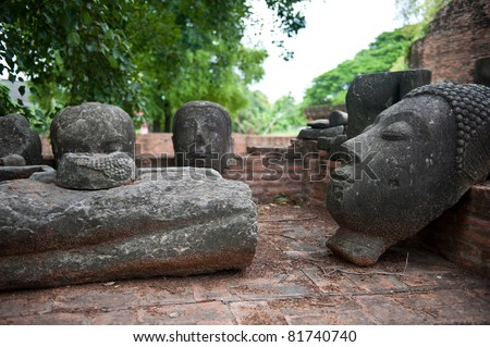 Head and body of a Buddha statue - stock photo