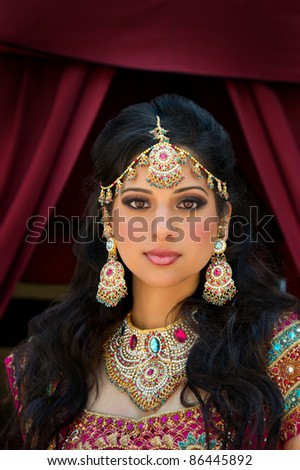 Head and shoulder portrait of a beautiful Indian bride - stock photo