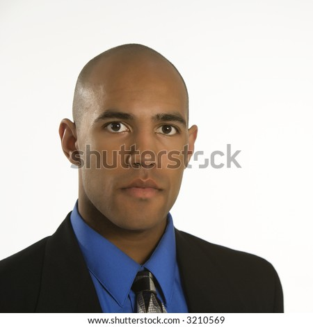 Head and shoulder portrait of African American man in suit. - stock photo