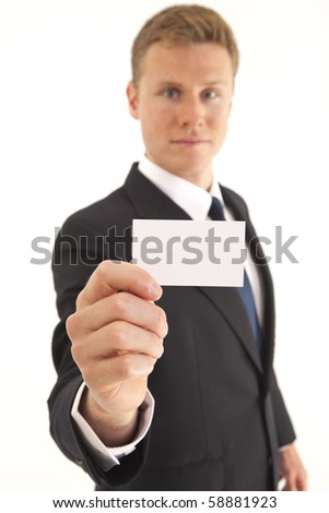 Head and shoulder portrait of businessman holding a blank business card - stock photo