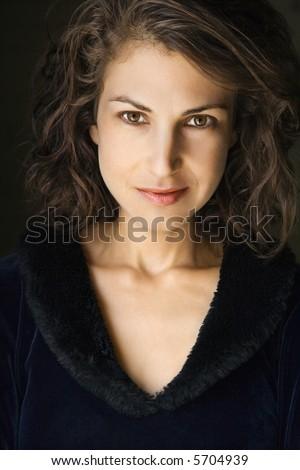 Head and shoulder portrait of pretty brunette woman. - stock photo