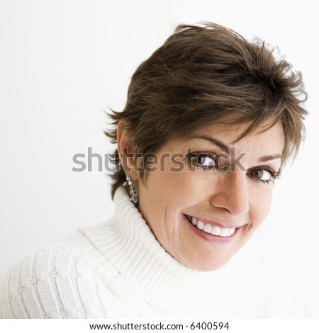 Head and shoulder portrait of pretty Caucasian woman smiling. - stock photo