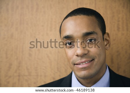 Head and shoulder portrait of smiling African-American mid-adult businessman. Horizontal format. - stock photo