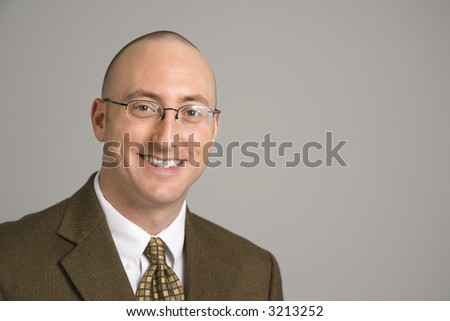 Head and shoulder portrait of smiling mid adult Caucasian businessman.