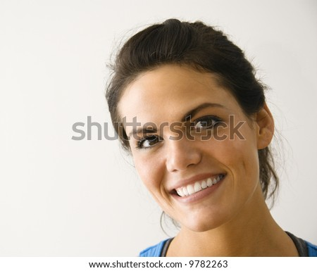 Head and shoulder portrait of woman smiling. - stock photo