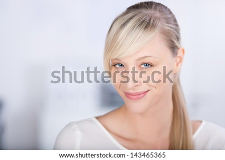 Head and shoulder shot of smiling casual female in a close up shot