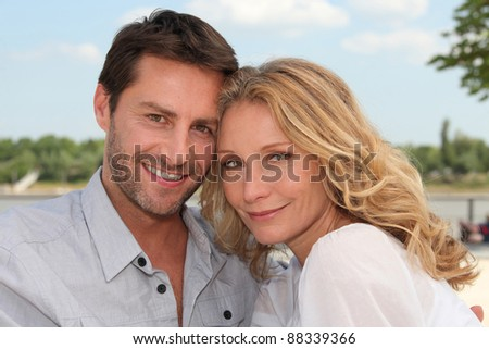 Head and shoulder shot of smiling couple - stock photo