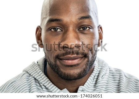 Head and shoulders close up portrait of a handsome black man in late 20s with no expression isolated on white background - stock photo