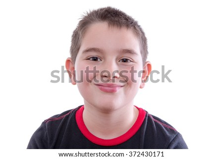 Head and Shoulders Close Up Portrait of Young Boy Wearing Red and Black T-Shirt and Smiling at Camera in Studio with White Background and Copy Space - stock photo