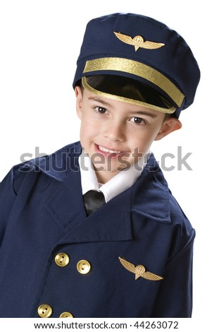 Head and shoulders image of a kindergarten boy in an over sized airline pilot's uniform.  Isolated on white. - stock photo