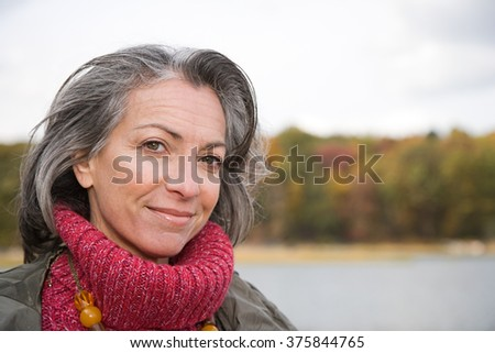 Head and shoulders of a mature woman - stock photo