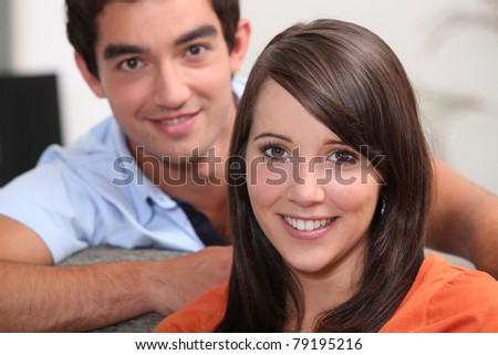 Head and shoulders of young couple - stock photo