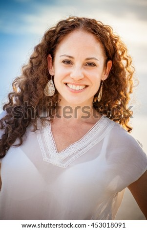 Head and shoulders portrait of a beautiful middle aged woman - stock photo