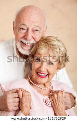 Head and shoulders portrait of a happy, beautiful senior couple.   - stock photo