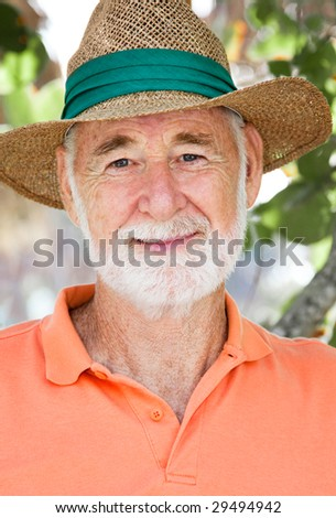 Head and shoulders portrait of a senior man with a world of wisdom and experience on his face. - stock photo